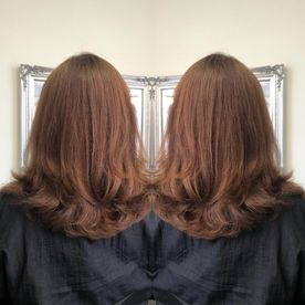 A woman that has got her hair cut shorter by our professionals